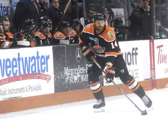 Katie Fyfe | The Journal Gazette  Komets forward Brett McKenzie carries the puck during the second period against the Idaho Steelheads at Memorial Coliseum on Friday.