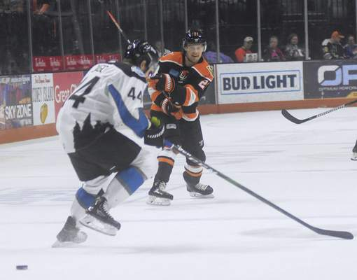 Katie Fyfe | The Journal Gazette  Komets forward Gage Torrel shoots the puck during the second period while Idaho's Tanner Jago tries to block it at Memorial Coliseum on Friday.