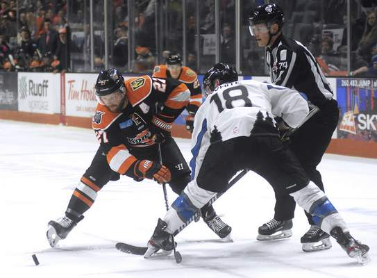 Katie Fyfe | The Journal Gazette  The Komets' Shawn Szydlowski watches the puck closely during a faceoff against Idaho's A.J. White at Memorial Coliseum on Friday.