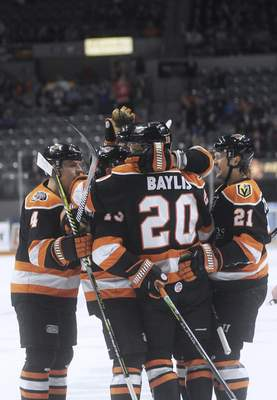 Katie Fyfe | The Journal Gazette  The Komets celebrate after forward Anthony Petruzzelli scored during the first period against Idaho Steelheads at Memorial Coliseum on Friday.