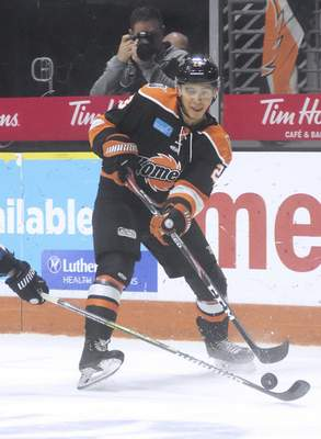 Katie Fyfe | The Journal Gazette  The Komets' Max Gottlieb makesa pass during the second period against the Idaho Steelheads at Memorial Coliseum on Friday.