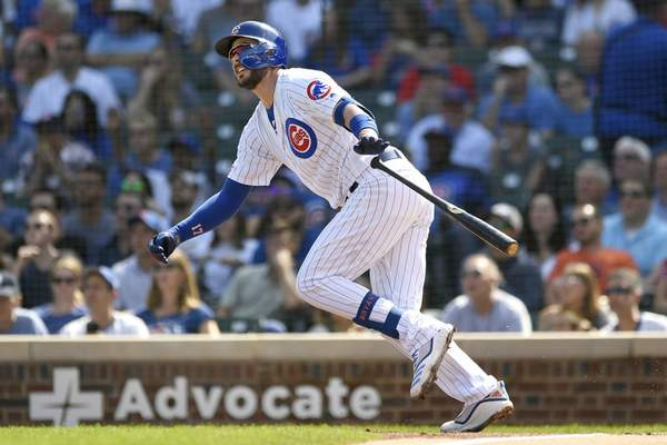 FILE - In this Sept. 15, 2019, file photo, Chicago Cubs' Kris Bryant watches his three-run home run during the first inning of a baseball game against the Pittsburgh Pirates in Chicago. Bryant avoided arbitration with the Cubs, agreeing Friday, Jan. 10, 2010, to an $18.6 million, one-year contract, a person familiar with the situation told The Associated Press. The person spoke on the condition of anonymity because the deal had not been announced. (AP Photo/Paul Beaty, File)