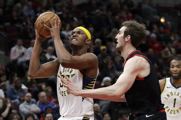 Associated Press Indiana's Myles Turner, left, drives to the basket against Luke Kornet during the first half Friday in Chicago.