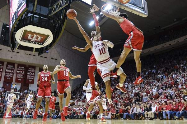 Associated Press: Indiana guard Rob Phinisee, center, shoots between Ohio State defenders Andre Wesson, in back, and D.J. Carton during the first half of an NCAA college basketball game in Bloomington on Saturday.