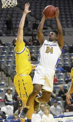 Katie Fyfe | The Journal Gazette  PFW Mastodons' junior Demierre Black shoots the ball while South Dakota State sophomore Alex Arians defends him during the first half at Memorial Coliseum on Saturday.