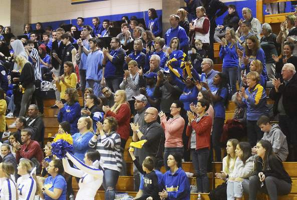 Katie Fyfe | The Journal Gazette  The crowd stands up and cheers after Homesteads win against Lawrence North at Homestead High School on Saturday.