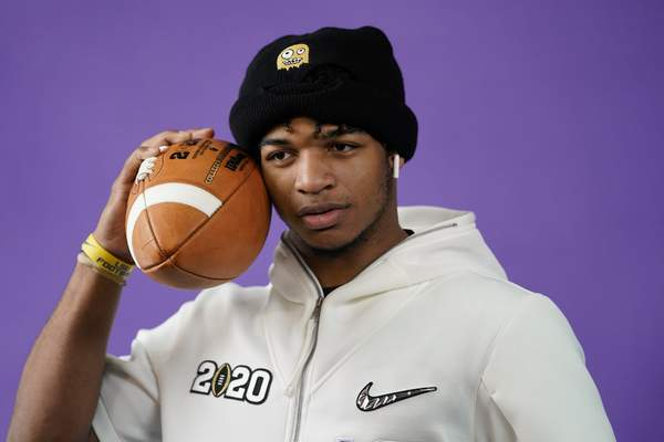 Associated Press LSU's Ja'Marr Chase poses during media day for NCAA College Football Playoff championship game Saturday in New Orleans.