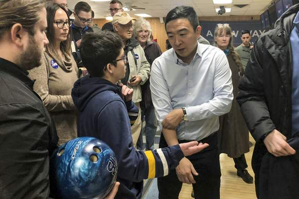 Associated Press  Democratic presidential candidate Andrew Yang gets ready to bowl following a campaign event last week in Clinton, Iowa.