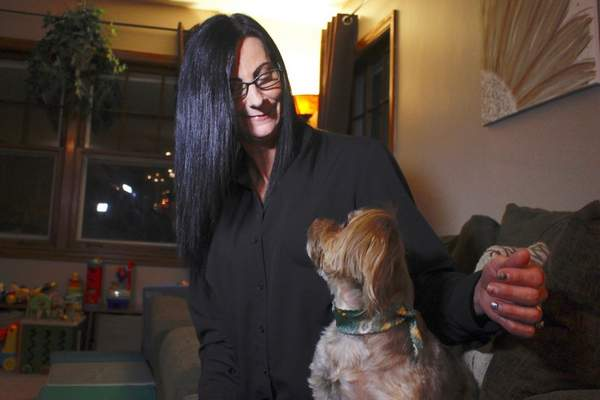 Associated Press photos  Amy Carter of St. Francis, Wis., says the CBD that she gives her dog Bentley has reduced  his epilepsy-related seizures. Sales of CBD have soared to become a $400 million market, growing tenfold since last year.