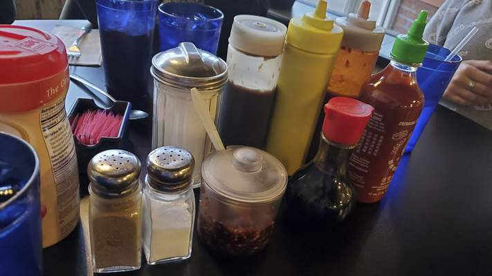 There are additives aplenty on the tables at Saigon Vietnamese restaurant on South Calhoun Street.