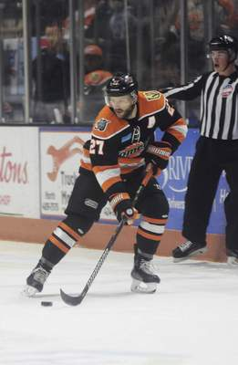 Katie Fyfe | The Journal Gazette  Komets forward Shawn Szydlowski recieves the puck during the first period against the Idaho Steelheads at Memorial Coliseum on Sunday.