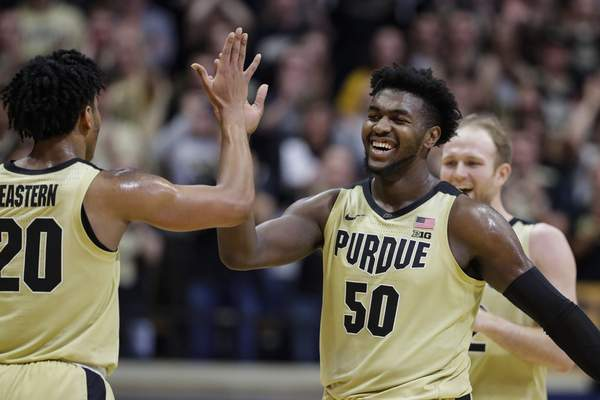 Purdue forward Trevion Williams celebrates with guard Nojel Eastern during the second half of Purdue's 71-42 win over No. 8 Michigan State. Williams had a game-high 16 points and added seven rebounds and four assists.(AP Photo/Michael Conroy)