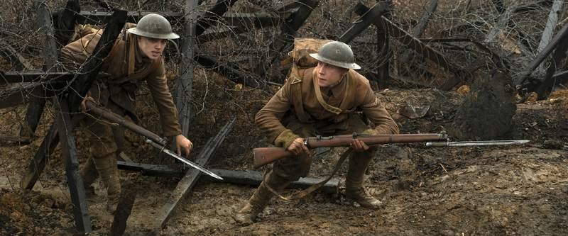 This image released by Universal Pictures shows Dean-Charles Chapman, left, and George MacKay in a scene from 1917, directed by Sam Mendes. (Francois Duhamel/Universal Pictures via AP)