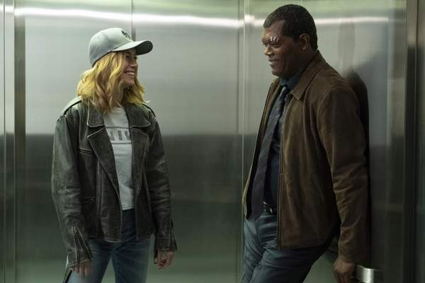 This image released by Disney-Marvel shows Samuel L. Jackson, right, with Brie Larson on the set of Captain Marvel. (Chuck Zlotnick/Disney/Marvel Studios via AP)