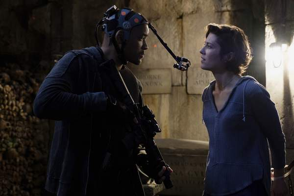 This image released by Paramount Pictures shows Will Smith, left, and Mary Elizabeth Winstead on the set of Gemini Man. (Ben Rothstein/Paramount Pictures via AP)