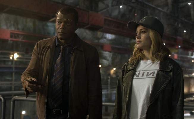 This image released by Disney-Marvel shows Samuel L. Jackson as a younger Nick Fury, left, and Brie Larson in a scene from Captain Marvel. (Disney/Marvel Studios via AP)