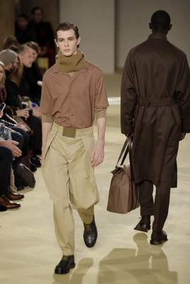 A model wears a creation part of the Salvatore Ferragamo men's Fall-Winter 2020/21 collection, that was presented during the fashion week, in Milan, Italy, Sunday, Jan. 12, 2020. (AP Photo/Luca Bruno)