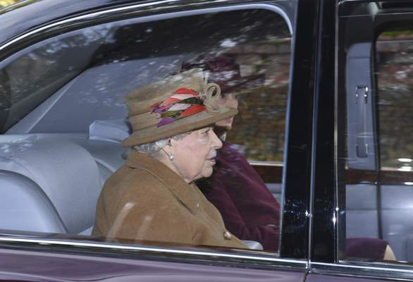 Britain's Queen Elizabeth II arrives to attend a morning church service at St Mary Magdalene Church in Sandringham, England, Sunday Jan. 12, 2020. (Joe Giddens/PA via AP)