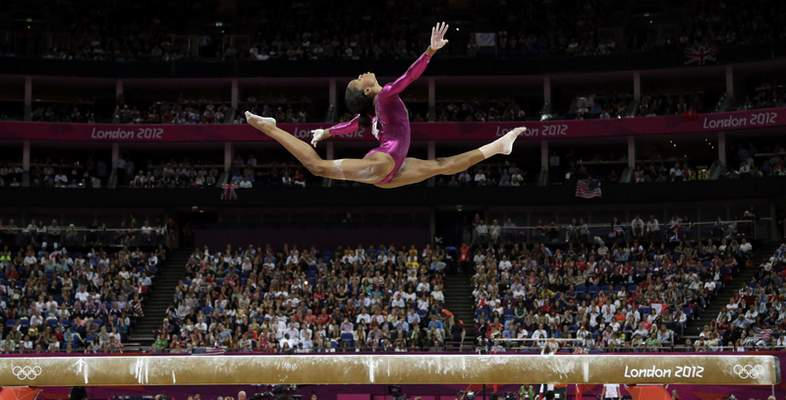 FILE - In this Aug. 2, 2012, file photo U.S. gymnast Gabby Douglas performs on the balance beam during the artistic gymnastics women's individual all-around competition at the 2012 Summer Olympics, in London. (AP Photo/Gregory Bull, File)