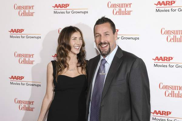Jackie Sandler and Adam Sandler attend the AARP 19th Annual Movies For Grownups Awards at the Beverly Wilshire hotel Saturday, Jan. 11, 2020, in Beverly Hills, Calif. (Photo by Mark Von Holden/Invision/AP)
