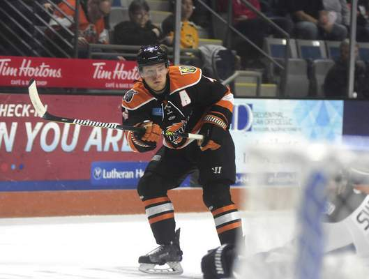 Katie Fyfe | The Journal Gazette Komets defenseman Jason Binkley watches his shot sail toward the goal during the first period of Sunday's game against the Steelheads at Memorial Coliseum.