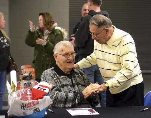 Katie Fyfe | The Journal Gazette  Komets Hall of Famer George Drysdale greets long time friend Richard Deleon during a meet and greet and signing autographs for the Harvester Homecoming Night with the Komets at the Allen County War Memorial Coliseum on Sunday, January 12th, 2020.