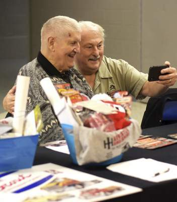 Katie Fyfe | The Journal Gazette  Komets Hall of Famer George Drysdale takes a selfie with Vice President of Harvestor Homecoming Jerry Betley during the Harvester Homecoming Night with the Komets at the Allen County War Memorial Coliseum on Sunday, January 12th, 2020.