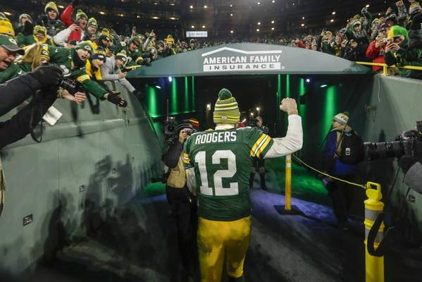 Associated Press Packers quarterback Aaron Rodgers celebrates as he walks off the field after Sunday's win over the Seahawks in Green Bay.