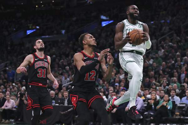 Associated Press Celtics guard Jaylen Brown drives past Bulls forward Daniel Gafford during Monday's game in Boston. Brown finished with 19 points