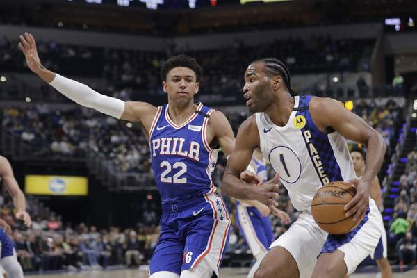 Indiana Pacers' T.J. Warren (1) is defended by Philadelphia 76ers' Matisse Thybulle (22) during the first half of an NBA basketball game, Monday, Jan. 13, 2020, in Indianapolis. (AP Photo/Darron Cummings)