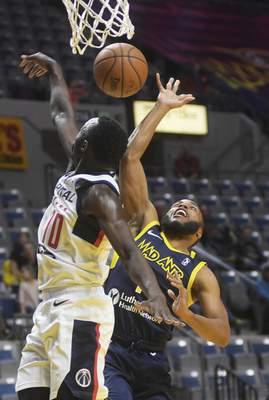 Katie Fyfe | The Journal Gazette  The Mad Ants' Tre Kelley has his shot blocked by the Capital City Go-Go's Jerian Grant during the third quarter at Memorial Coliseum on Monday.