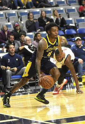 Katie Fyfe | The Journal Gazette  The Mad Ants' Daxter Miles Jr. drivesduring the third quarter against the Capital City Go-Go at Memorial Coliseum on Monday.