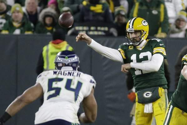 Green Bay Packers' Aaron Rodgers throws during the second half of an NFL divisional playoff football game against the Seattle Seahawks Sunday, Jan. 12, 2020, in Green Bay, Wis. (AP Photo/Mike Roemer)