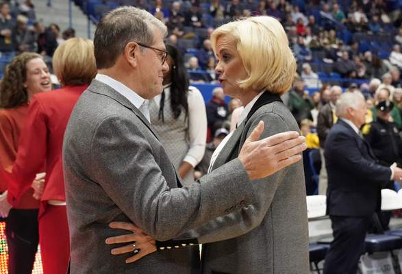 Connecticut coach Geno Auriemma, left, and Baylor coach Kim Mulkey talk before an NCAA college basketball game Thursday, Jan. 9, 2020, in Hartford, Conn. (AP Photo/Jessica Hill)