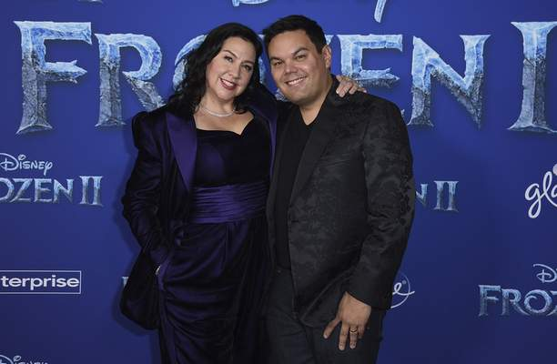 FILE - This Nov. 7, 2019 file photo shows songwriters Kristen Anderson-Lopez, left, and Robert Lopez at the world premiere of Frozen 2 in Los Angeles. T(Photo by Jordan Strauss/Invision/AP, File)