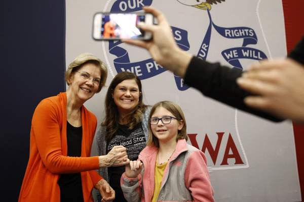 Democratic presidential candidate Sen. Elizabeth Warren, D-Mass., left, poses for a photo with attendees after speaking at a campaign event, Sunday, Jan. 12, 2020, in Marshalltown, Iowa. (AP Photo/Patrick Semansky)