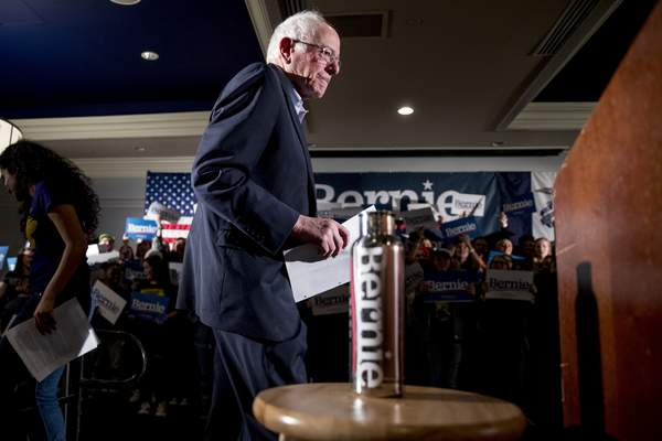 Democratic presidential candidate Sen. Bernie Sanders, I-Vt., takes the stage at a climate rally with the Sunrise Movement at The Graduate Hotel, Sunday, Jan. 12, 2020, in Iowa City, Iowa. (AP Photo/Andrew Harnik)