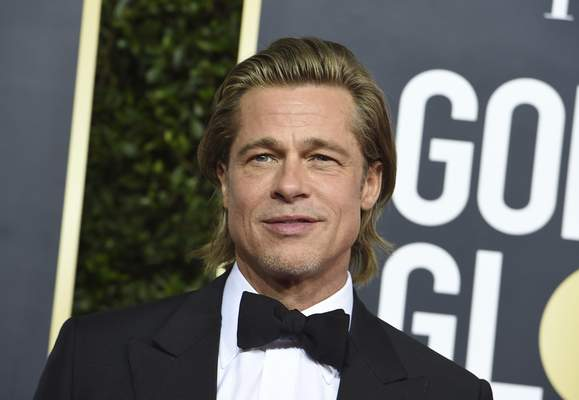 Brad Pitt arrives at the 77th annual Golden Globe Awards at the Beverly Hilton Hotel on Sunday, Jan. 5, 2020, in Beverly Hills, Calif. (Photo by Jordan Strauss/Invision/AP)