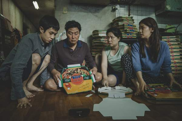 This image released by Neon shows Woo-sik Choi, from left, Kang-ho Song, Hye-jin Jang and So-dam Park in a scene from Parasite. (Neon via AP)