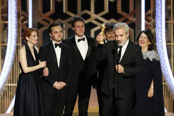 This image released by NBC shows filmmaker Sam Mendes accepting the award for best motion picture drama for 1917 at the 77th Annual Golden Globe Awards at the Beverly Hilton Hotel in Beverly Hills, Calif., on Sunday, Jan. 5, 2020. (Paul Drinkwater/NBC via AP)