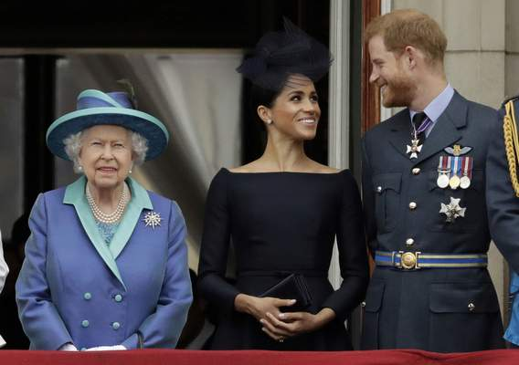Associated Press Queen Elizabeth II stands with Meghan the Duchess of Sussex and Prince Harry in 2018. Prince Harry and the Duchess have received the queen's blessing to live part time in Canada.