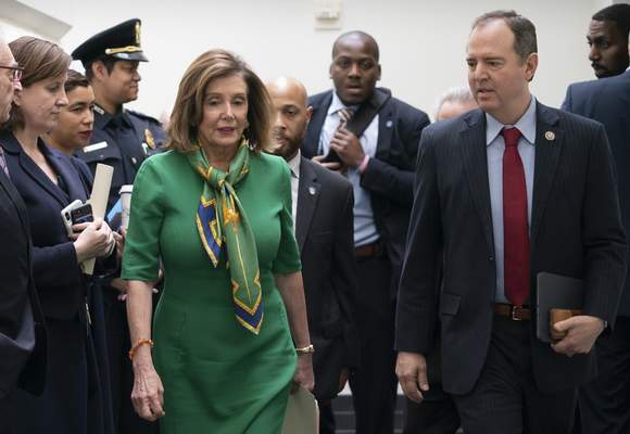 Speaker of the House Nancy Pelosi, D-Calif., joined by House Intelligence Committee Chairman Adam Schiff, D-Calif., leaves a lengthy closed-door meeting with the Democratic Caucus at the Capitol in Washington, Tuesday, Jan. 14, 2020. (AP Photo/J. Scott Applewhite)