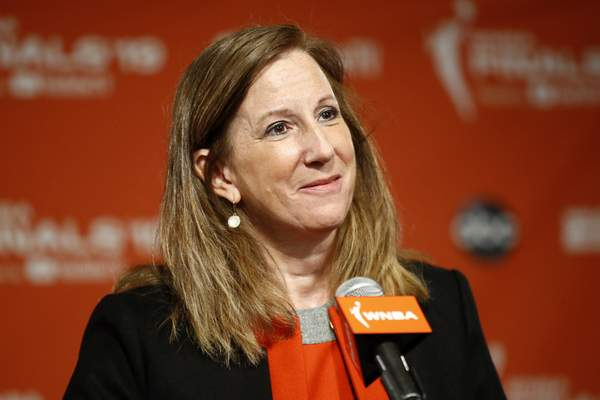 FILE - In this Sept. 29, 2019, file photo, WNBA Commissioner Cathy Engelbert speaks at a news conference in Washington. The WNBA and its union announced a tentative eight-year labor deal Tuesday, Jan. 14, 2020, that will allow top players to earn more than $500,000 while the average annual compensation for players will surpass six figures for the first time. I call it historic, WNBA Commissioner Cathy Engelbert said in a phone interview. (AP Photo/Patrick Semansky, File)