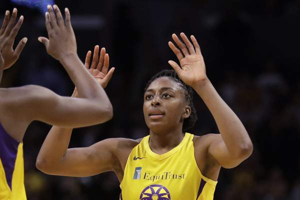 """FILE - In this Friday, May 31, 2019, file photo, Los Angeles Sparks' Chiney Ogwumike (13), obscured at left, and her sister Nneka Ogwumike celebrate after a win over the Connecticut Sun in a WNBA basketball game in Los Angeles. The WNBA and its union announced a tentative eight-year labor deal Tuesday, Jan. 14, 2020, that will allow top players to earn more than $500,000 while the average annual compensation for players will surpass six figures for the first time. """"It was collaborative effort,' WNBA players' union president Nneka Ogwumike said. (AP Photo/Marcio Jose Sanchez, File)"""