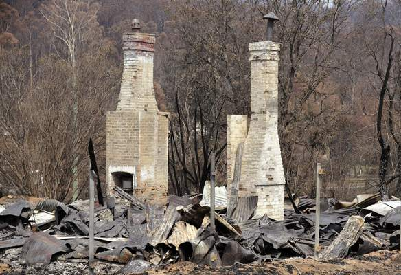 Two brick fireplaces are all that are left of a historic town store at Nerrigundah, Australia, Monday, Jan. 13, 2020, after a wildfire ripped through the town on New Year's Eve. (AP Photo/Rick Rycroft)
