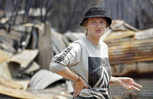 Skye Threlfall talks about how she and her brother and sister saved their house a New Year's Eve wildfire at Nerrigundah, Australia, Monday, Jan. 13, 2020. (AP Photo/Rick Rycroft)