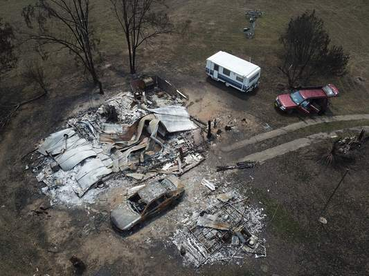 The home of Lyle Stewart is razed to the ground at Nerrigundah, Australia, Monday, Jan. 13, 2020, after a wildfire ripped through the town on New Year's Eve. (AP Photo/Sam McNeil)