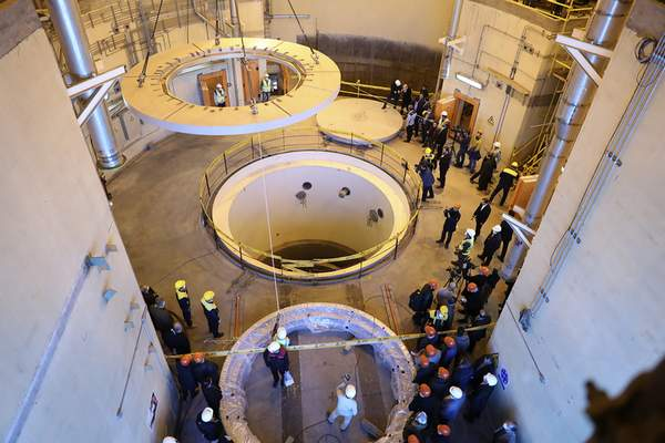 FILE - In this Dec. 23, 2019 file photo released by the Atomic Energy Organization of Iran, technicians work at the Arak heavy water reactor's secondary circuit, as officials and media visit the site, near Arak, Iran. (Atomic Energy Organization of Iran via AP, File)
