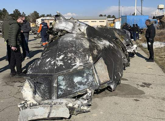 This undated photo provided by the Ukrainian Presidential Press Office, shows the wreckage of the Ukraine International Airlines Boeing 737-800 at the scene of the crash in Shahedshahr, southwest of the capital Tehran, Iran. (Ukrainian Presidential Press Office via AP)