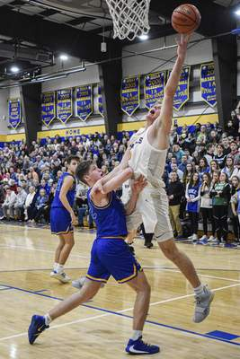 Mike Moore | The Journal Gazette Blackhawk Christian's Caleb Furst reaches for an errant pass in the second quarter Tuesday against Homestead at Blackhawk Christian. Furst scored 25 in the Braves' loss.